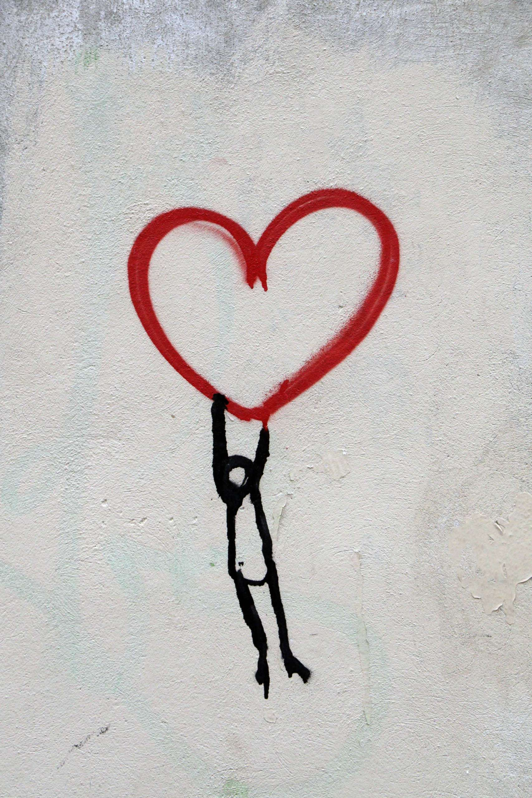 person hanging on heart